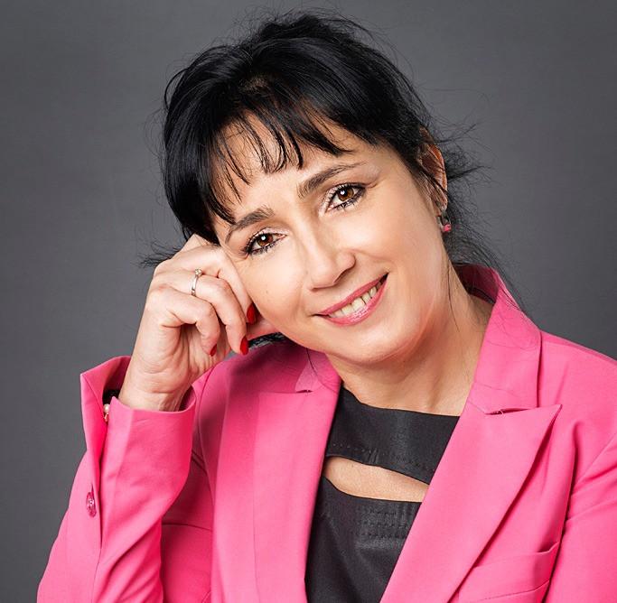 Mrs. Nora Batova smiling