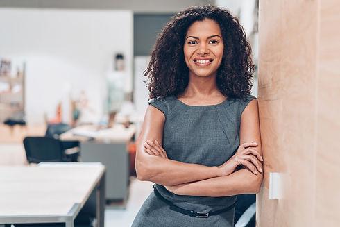 smiling Hispanic business women  sharing MENITY values