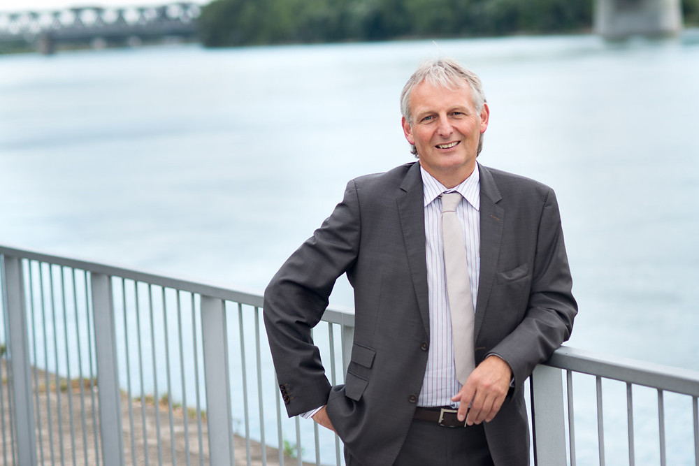 Mr. Lichtenauer standing and smiling close to Danube river