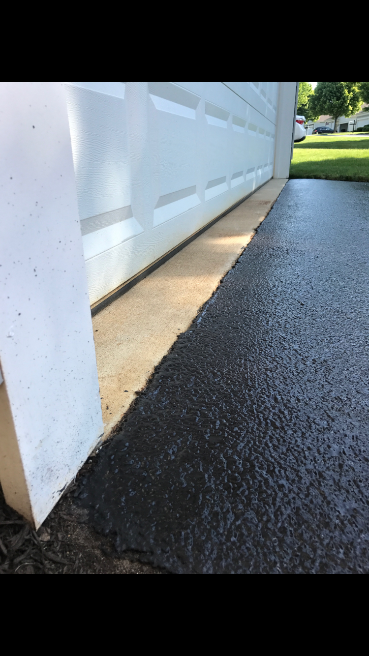 Clean driveway sealcoating