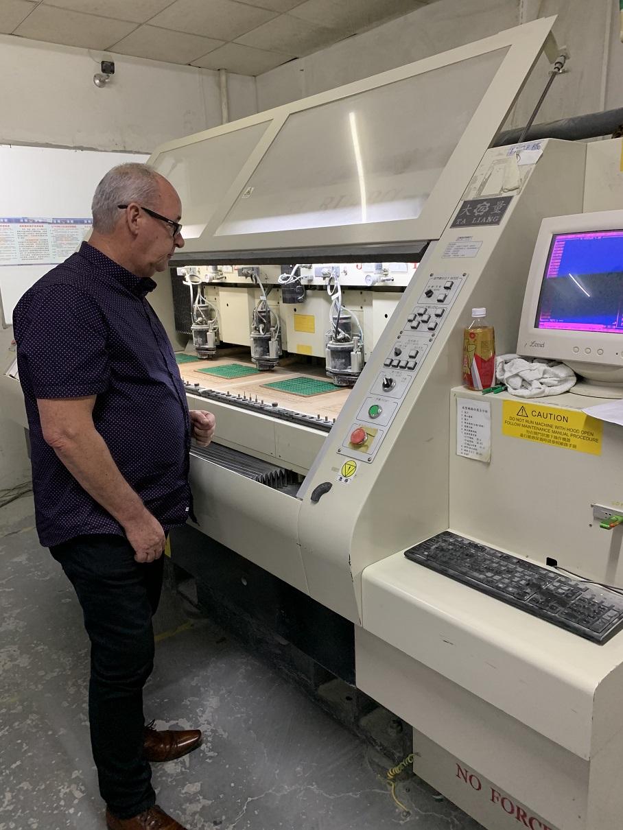 Rob inspects a CNC Drilling Machine