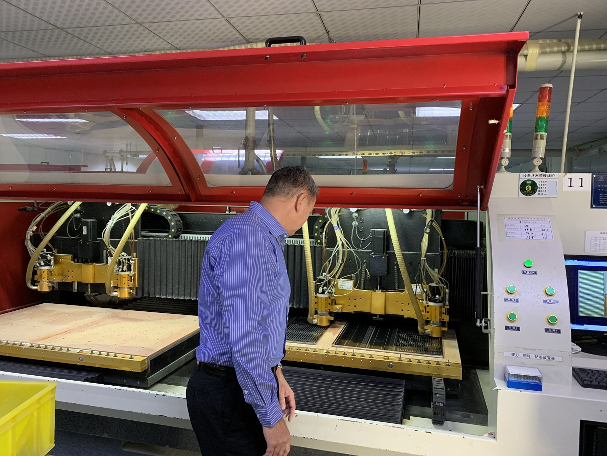 I inspect another CNC drilling machine