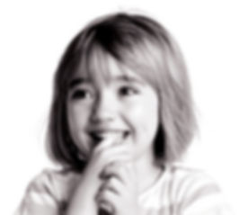 Little girl smiling with her finger in her mouth