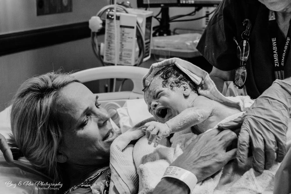 Mom holding baby for the first time-at Saddleback Memorial Hospital-Bug and Roo Photography-Labor and Delivery Photographer-Laguna Hills-Doctor Raffo-Women's Clinic-Orange County