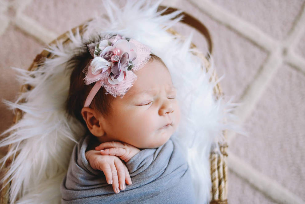 Baby in wrap with bow-bug and Roo Photography-Newborn Photographer-Costa Mesa-Orange County