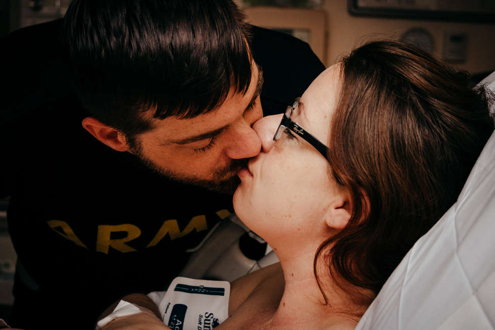 Dad kissing mom after baby is born at Kaiser Permanente Hospital-Bug and Roo Photography-Birth Photographer-Anaheim-Orange County