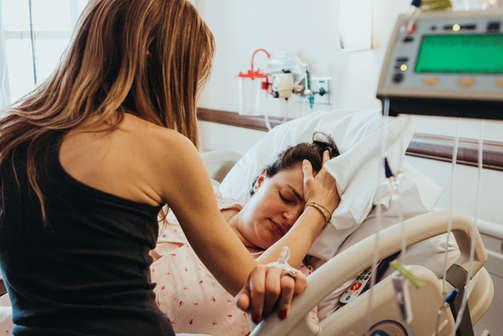 Doula embracing expectant mom|Bug ad Roo Photography | Orange County Birth Photographer | Saddleback Hospital