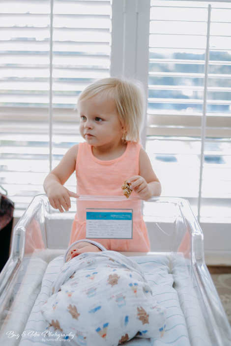 Big sister looking at baby brother at Women Clinic Saddleback Memorial Hospital-Doctor Raffo-Bug and Roo Photography-Fresh 48 Photographer-Laguna Hills-Orange County