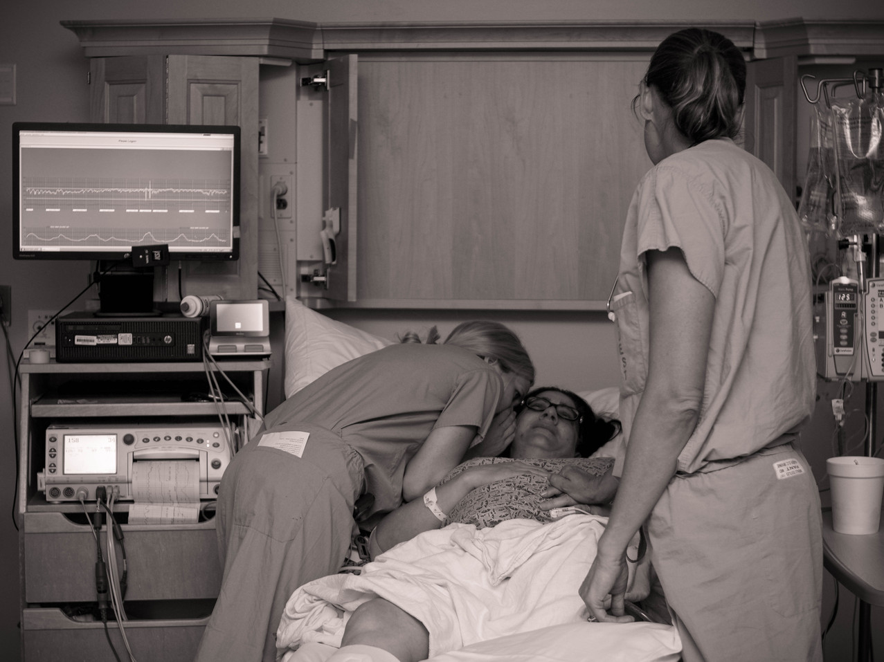 Nurse Whispering to mom right before delivering baby at Kaiser Hospital-Bug and Roo Photography-Birth Photographer-Newport Beach, Orange County