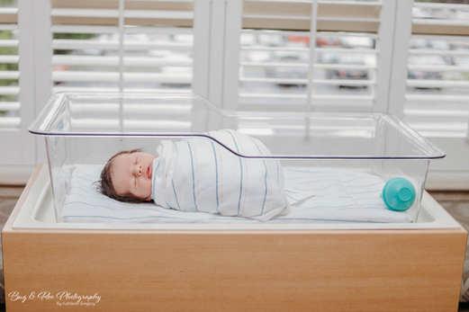 One day old baby sleeping next to window at Women Clinic Saddleback Memorial Hospital-Doctor Raffo-Bug and Roo Photography-Fresh 48 Photographer-Laguna Hills-Orange County