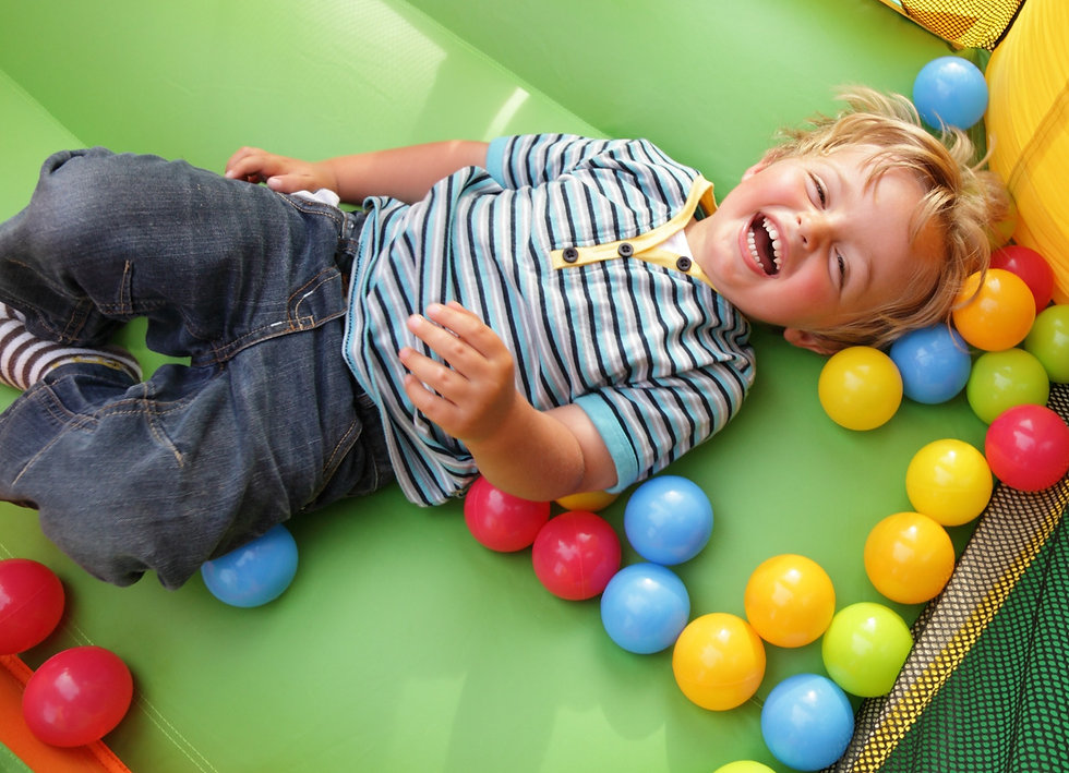 Berlin Activities Depot - Your One-Stop-Shop for Family Fun and Activities: Happy preschool aged boy in bounce house will balls.