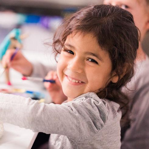 Zoo Crew: Preschool girl working on her art project.
