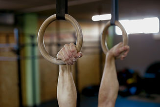 Twisters Recreational Gymnastics Program: Close up of male gymnast hands on rings.