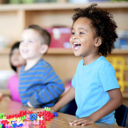 Leaping Lizards: Happy child in the childcare classroom.