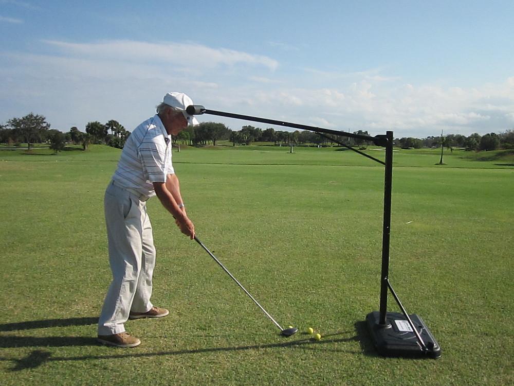 Bob Doyle demonstrating the Pro-Head 2 golf swing trainer