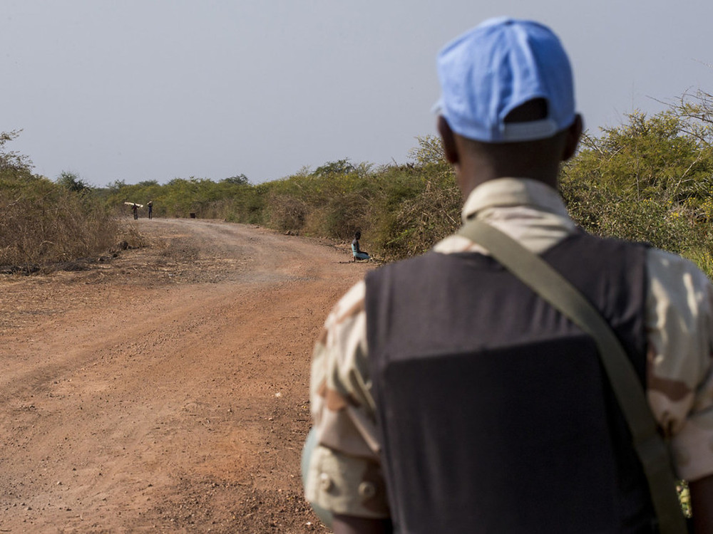 UNMISS Photo In this file photograph, an UNMISS peacekeeper patrols a road near Bentiu, Unity state, South Sudan. Patrols such as these serve to show a presence and to provide protection in the area.