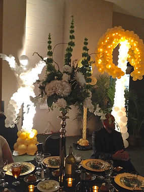 white balloons gold balloons black white party floral centerpieces