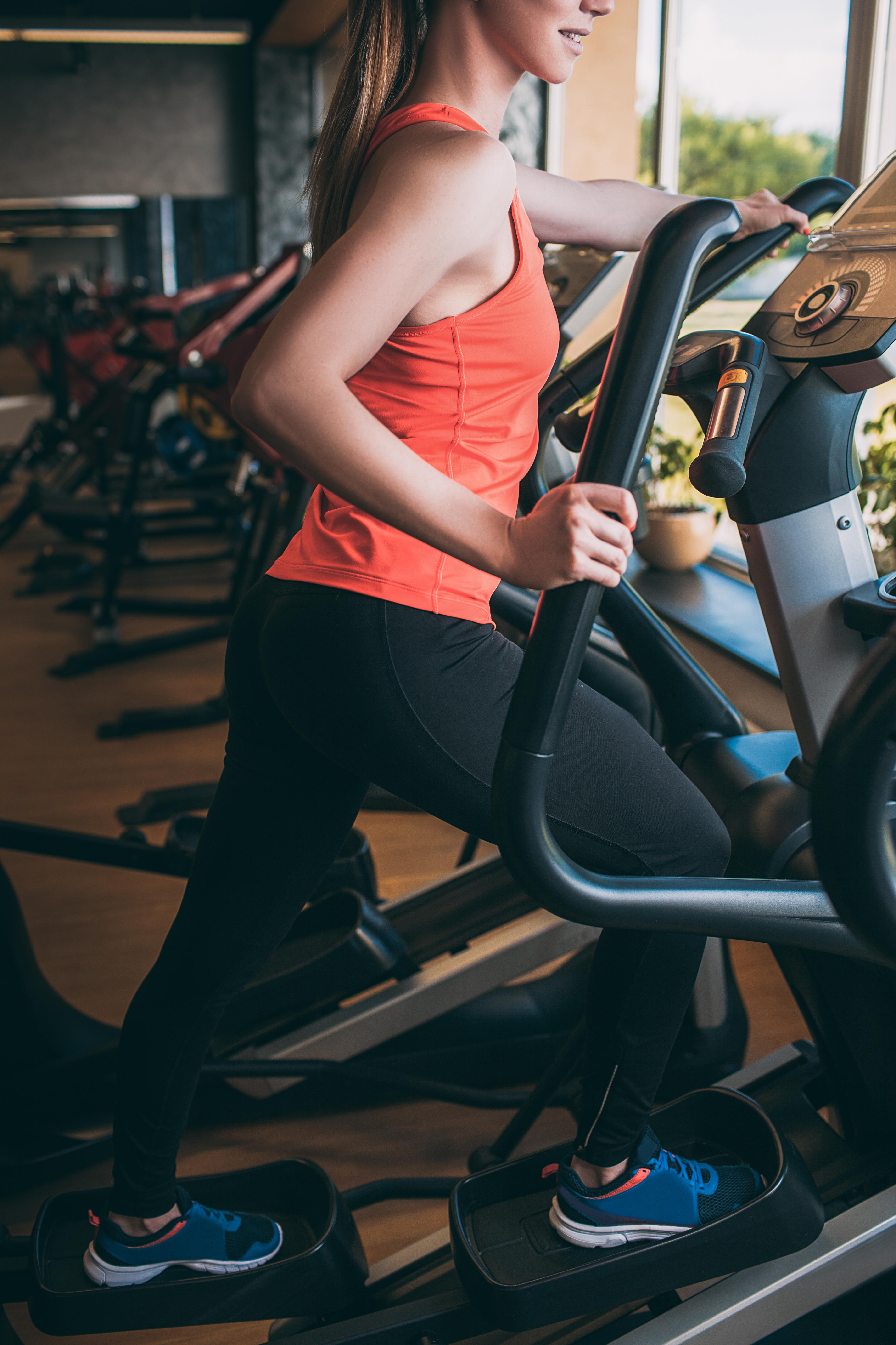 Sport girl run orbitrek gym body fitness concept.jpg Hard cardio workout.jpg All for the    of achie