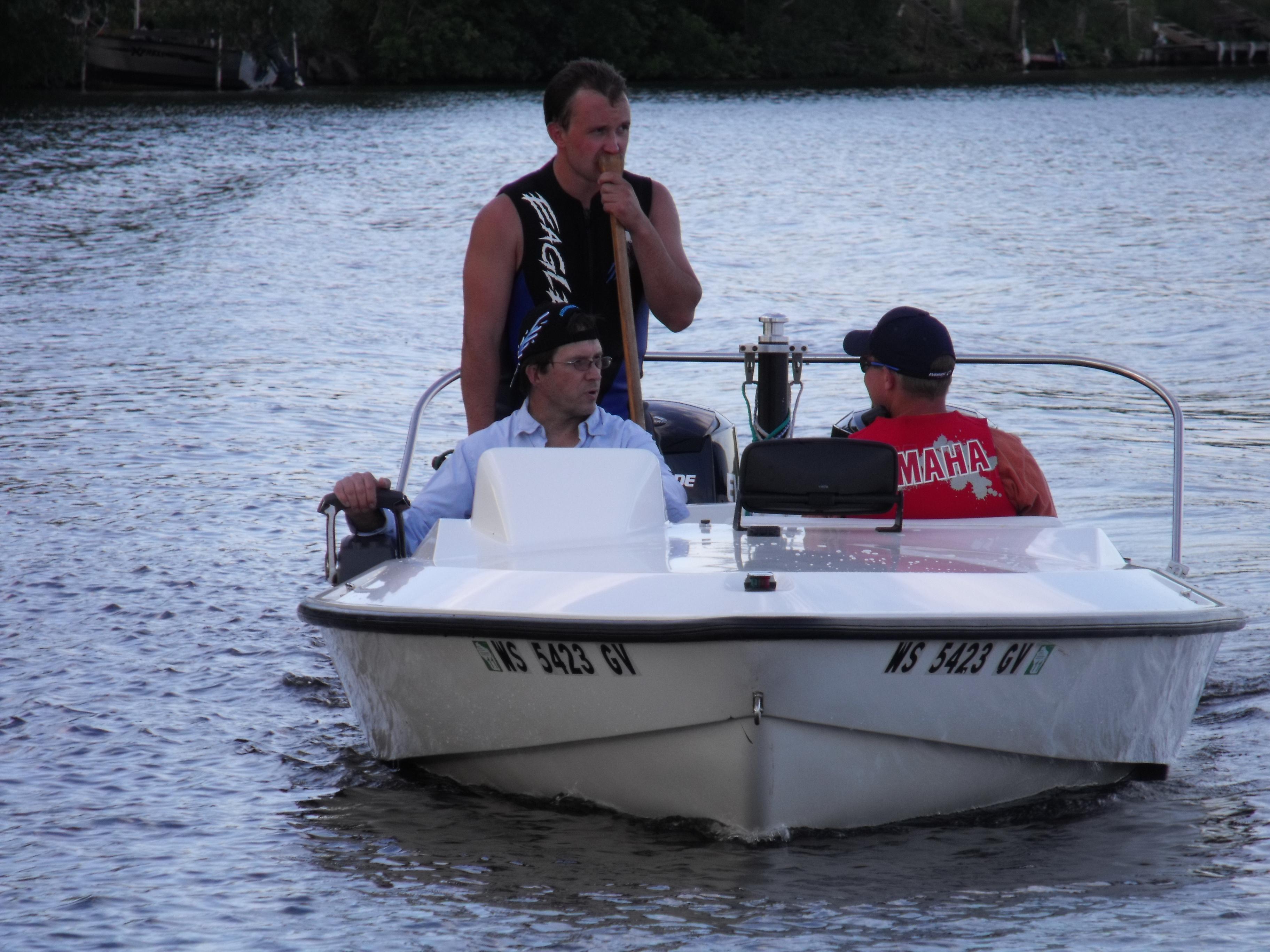 Ken Kevin Adam in boat w canoe paddle