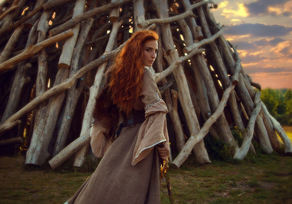 shieldmaiden - female viking warrior with long red hair