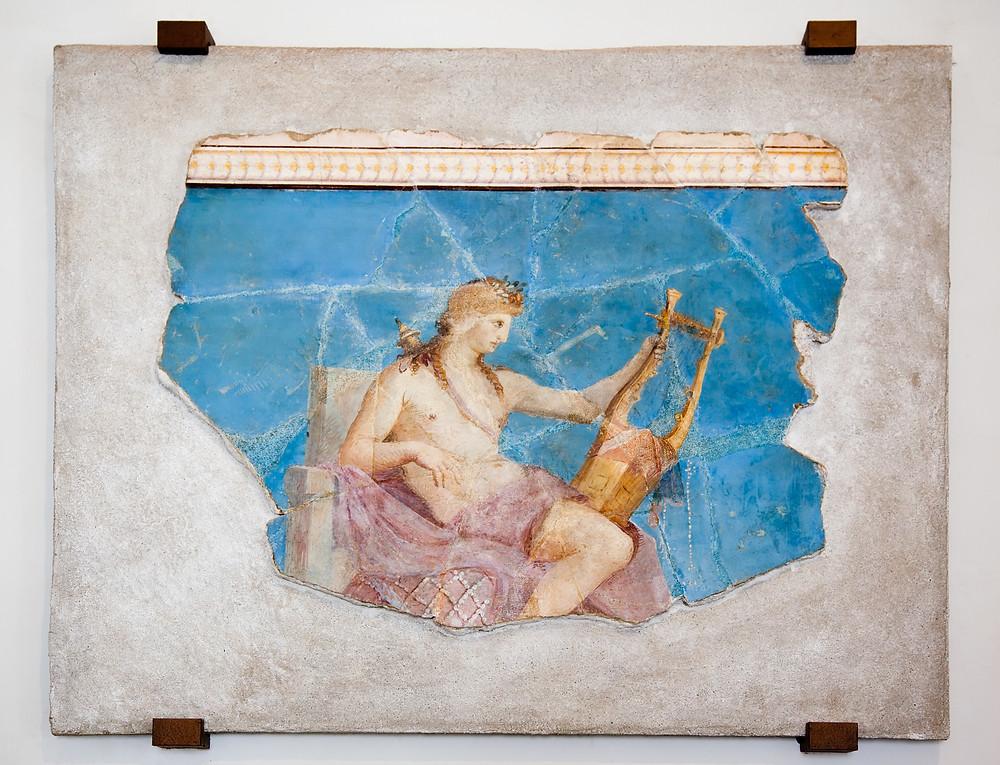 Fresco of the Greek God Apollo playing a harp