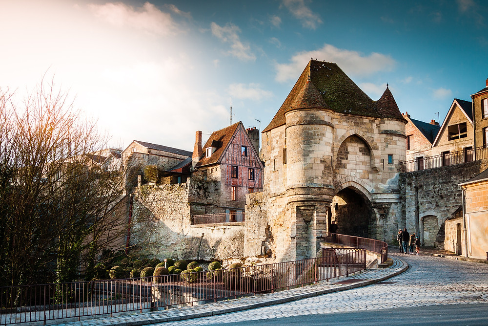 Medieval gate into a French village in sunshine