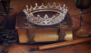 A queens crown resting on an old book.