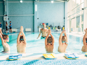 kids-doing-exercise-in-swimming-pool-PGZ