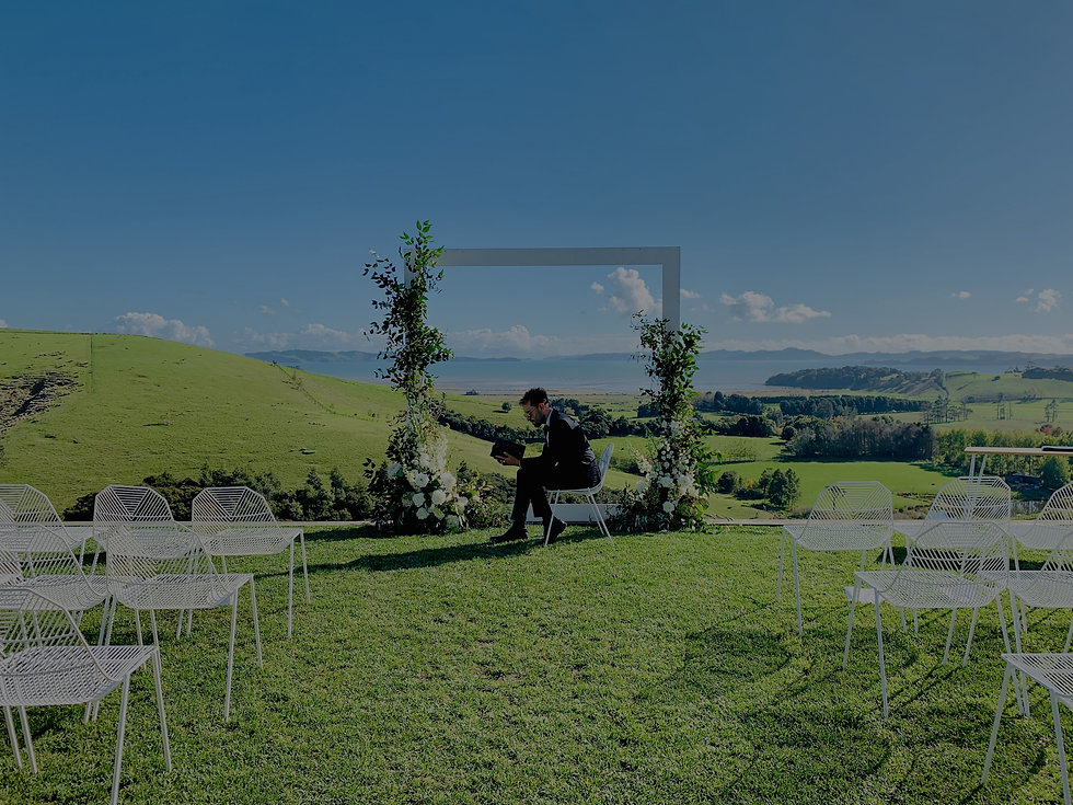 Wedding Celebrant going over ceremony at Kauri Bay Boomrock, Auckland