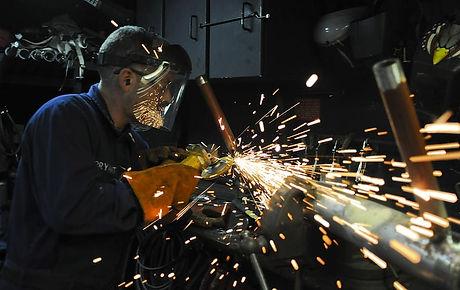 construction-worker-metal-grinder.jpg