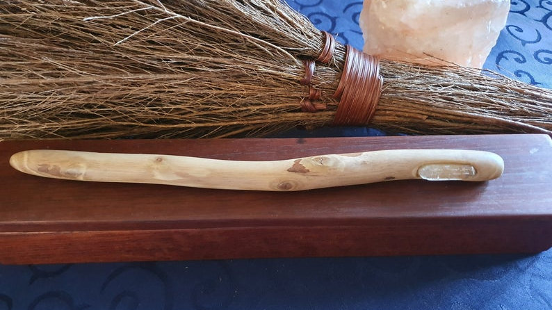 Magic within a wand hand made from eucalyptus wood featuring a faceted quartz