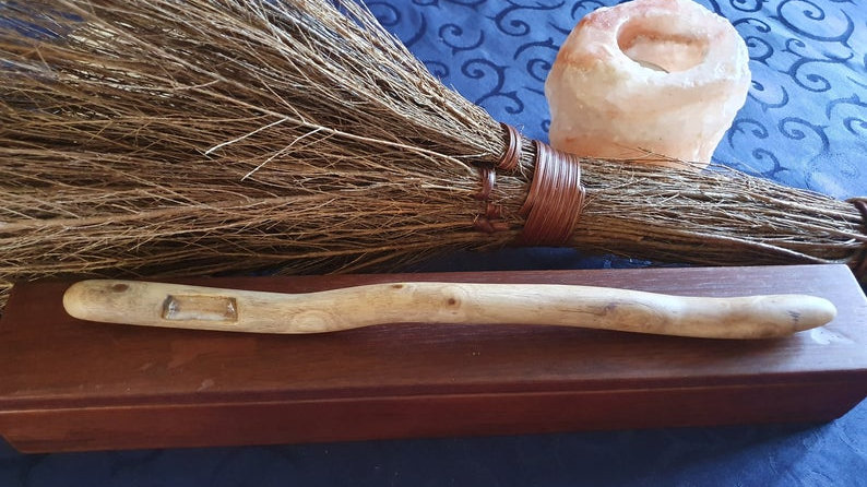 Magic with a hand made wand featuring a natural quartz