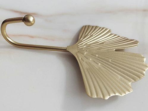 Gold wall hook.