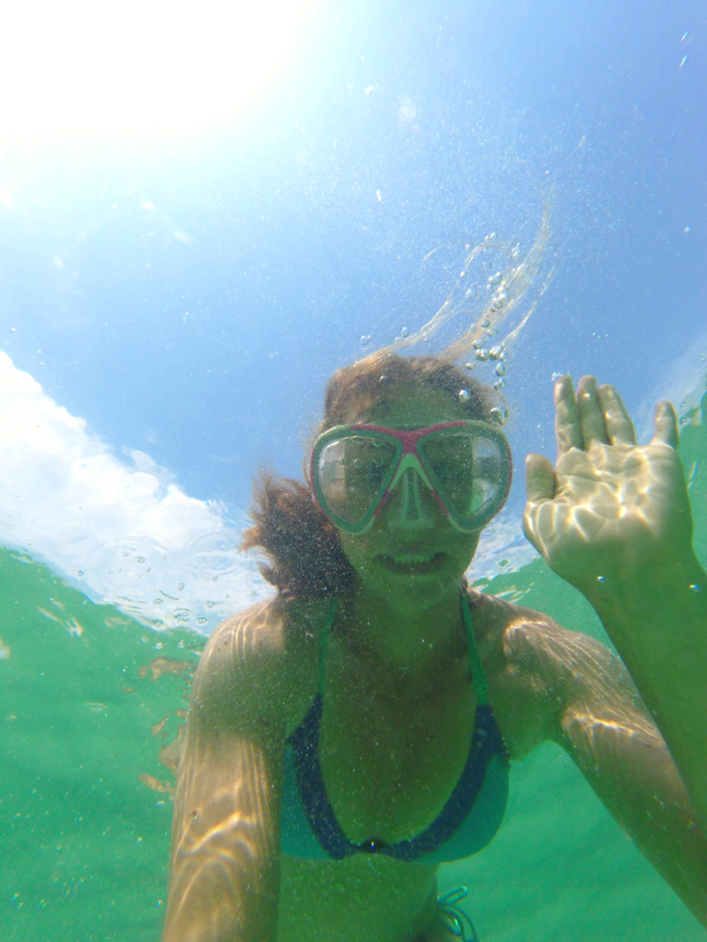The author ditching her snorkel to spy the deeper depths of Destin's snorkeling