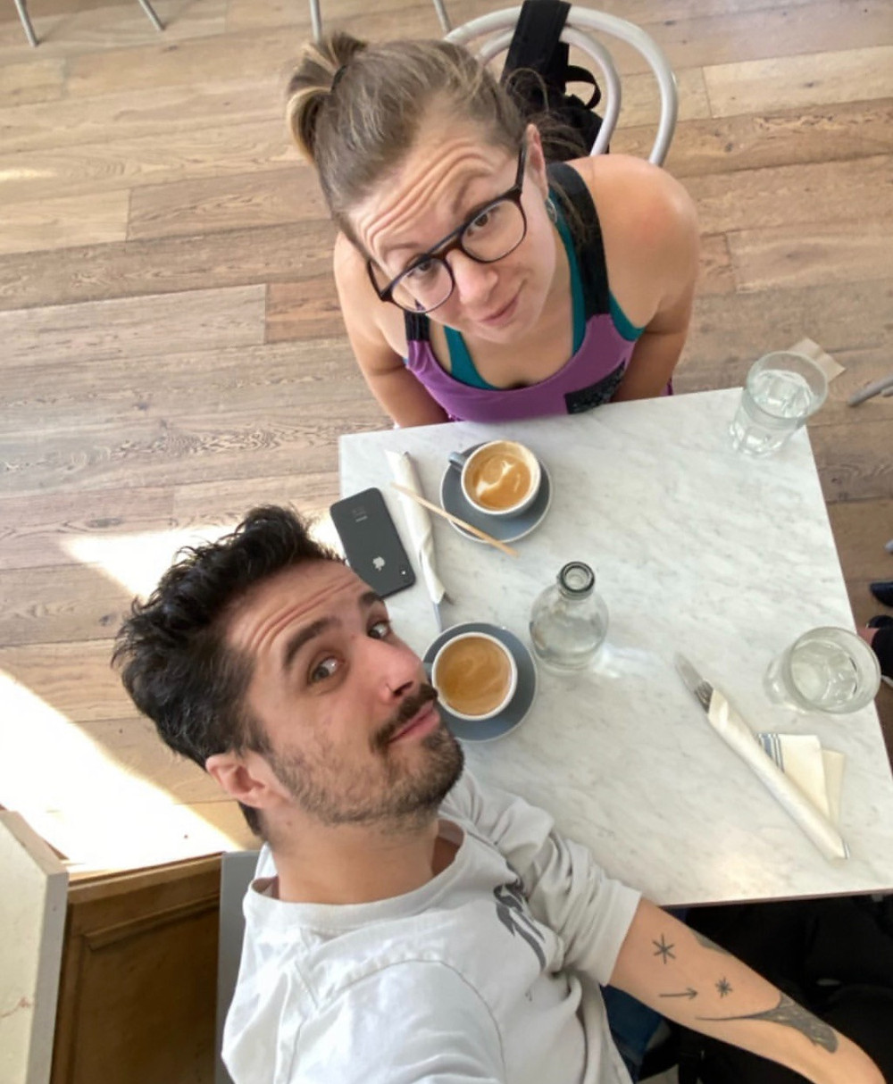 Woman and man drinking a flat white and a cappuccino in a cafe in San Fransisco