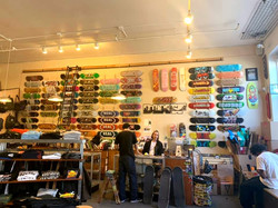 Skateboards on wall in Deluxe skate shop, San Fransisco