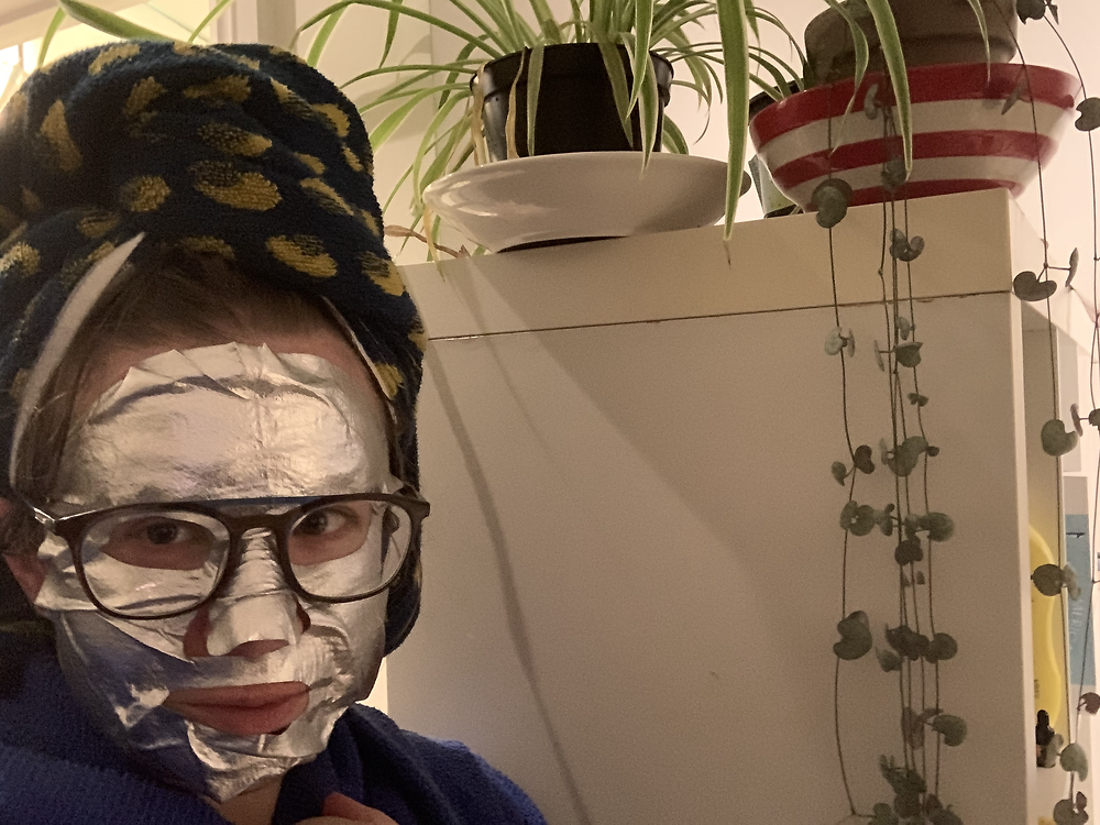 Woman wearing silver facemask
