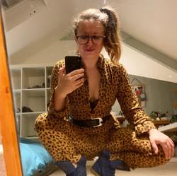 Woman in leopard print jumpsuit