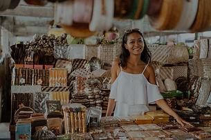 A woman standing at a souvenir store_edi