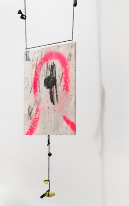 A Lie Nation: Bundy Bundle, oil painting on Malheur Refuge map, spray painted rocks, and hand-twined black cordage, 2017,