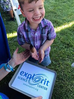 little boy holding bug edited.jpg