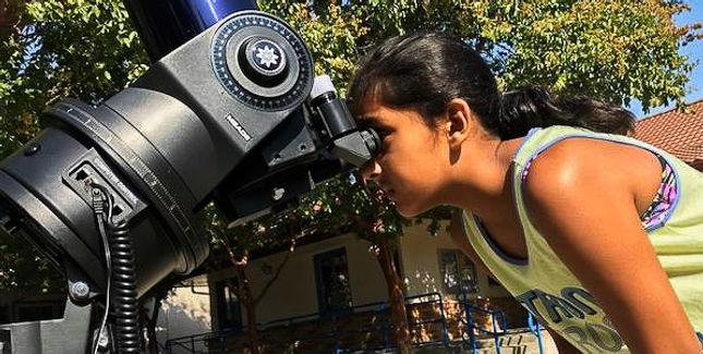 looking through telescope edited.jpg