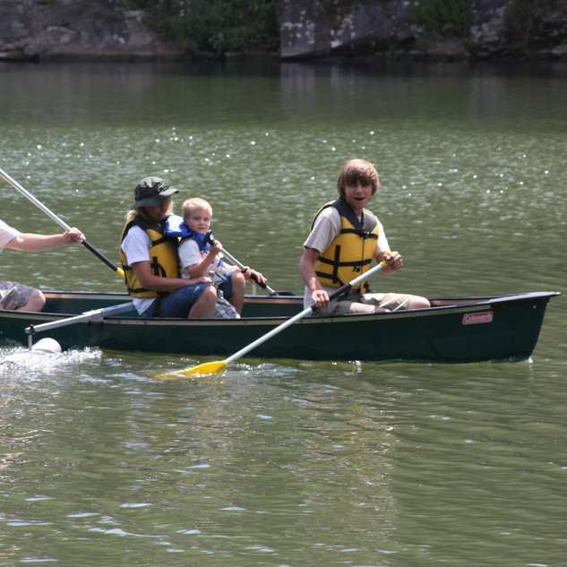 Family paddles around the Cove