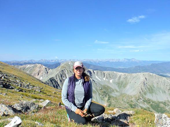 Katy enjoying a break at the top of Byers Peak, Fraser CO 8.14.17