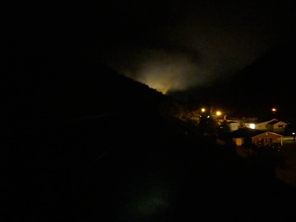 Pitch black roads with an eerie mist coming out of the mountains.