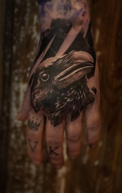 Raven hand tattoo