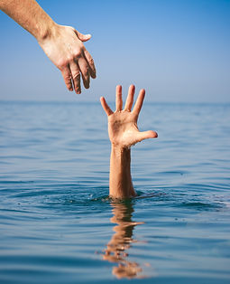 helping hand giving to drowning man in s