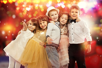 Group of happy kids in celebratory cloth