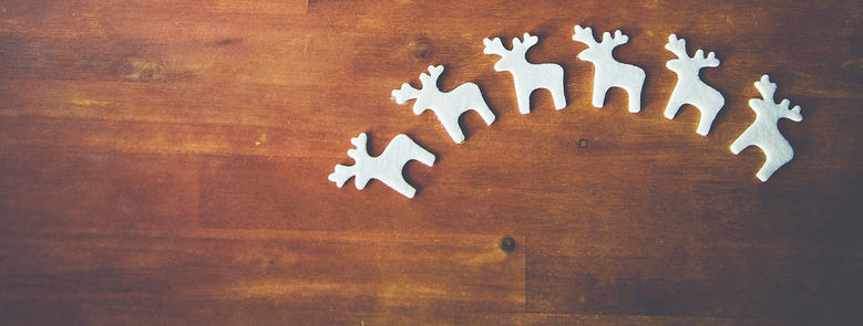 White%20Reindeer%20on%20Wooden%20Surface