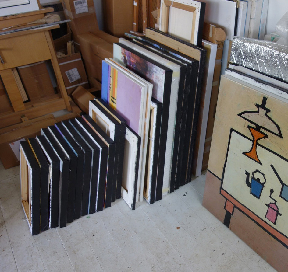 stack of canvases in studio